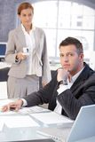 Secretary serving young boss with coffee Stock Photos