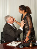 Secretary sexual harassment. Secretary defending herself with her scissors against intimacy by her boss Royalty Free Stock Photo