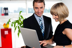 Secretary showing power point presentation to the boss Royalty Free Stock Image
