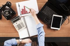 Secretary shows the increase on the chart, top view on the desk stock photos