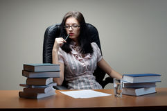 Secretary sit at the table. In an armchair royalty free stock images