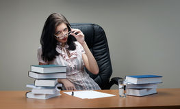 Secretary sit at the table. In an armchair royalty free stock photography