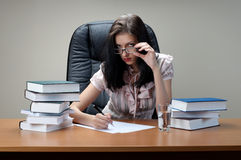 Secretary sit at the table. In an armchair royalty free stock image