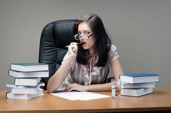 Secretary sit at the table. In an armchair stock image
