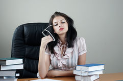 Secretary sit at the table. In an armchair stock photography