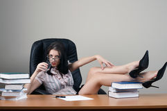 Secretary sit at the table. In an armchair stock images