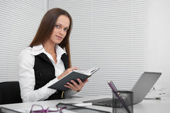 Secretary sitting at desk Royalty Free Stock Images