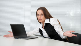 Secretary sitting at desk Royalty Free Stock Photo