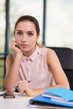 Secretary sitting at the desk Stock Image