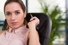 Secretary sitting in leather chair Stock Photo