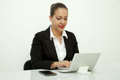 Secretary sitting in the Office Royalty Free Stock Photos
