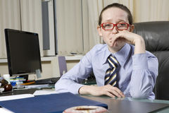 Secretary sitting at table Stock Photography