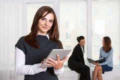 Secretary smiling girl reads the information from the tablet Stock Photo
