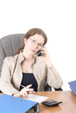 The secretary speaks on phone. Portrait of the business woman with phone, isolated over white Royalty Free Stock Photography
