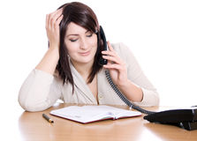 Secretary speaks on the phone during business hours Stock Photos