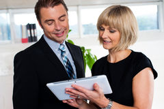 Secretary with tablet pc discussing bosses schedule Royalty Free Stock Photo