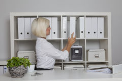Secretary takes a folder from the cabinet Royalty Free Stock Images