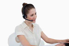 Secretary talking through a headset Royalty Free Stock Photos