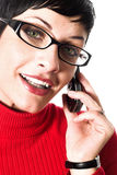 Secretary talks on mobile. Beautiful young woman with charming big green eyes is bearing modern glasses and receiving calls on a mobile phone Stock Photos