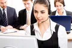 Secretary/telephone operator. A friendly secretary/telephone operator in an office environment Royalty Free Stock Image