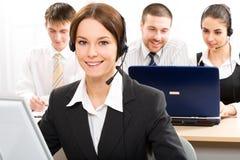 Secretary/telephone operator. A friendly secretary/telephone operator in an office environment Stock Photo