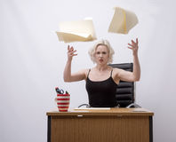 Secretary throwing papers into the air Stock Photography