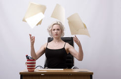 Secretary throwing papers into the air Royalty Free Stock Photography
