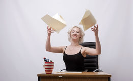 Secretary throwing papers into the air Royalty Free Stock Image