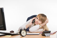 The secretary is tired of the endless phone calls Stock Image