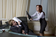 Secretary trying to beat her boss Royalty Free Stock Photography