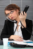 Secretary with two phones Royalty Free Stock Photography