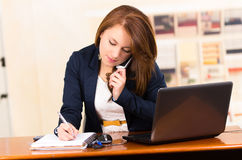 Secretary using cell phone Royalty Free Stock Image