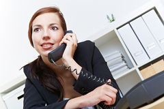 Secretary using phone in office Royalty Free Stock Photography
