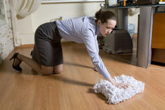 Secretary washes the floor Royalty Free Stock Photos