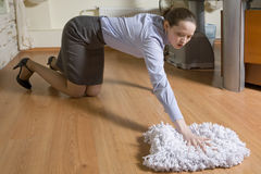 Secretary washing the floor in office Royalty Free Stock Photography