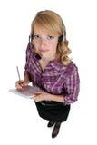 Secretary wearing headset Royalty Free Stock Image