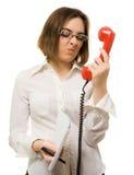 Secretary wincing to headset Stock Photos