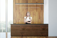 Secretary at wooden reception. Confident young secretary at wooden reception desk. 3D Rendering Royalty Free Stock Photos