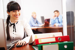 Secretary at work. Busy secretary looking at camera in the office Stock Image