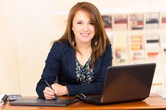 Secretary working with laptop and tablet Stock Image