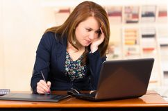 Secretary working with laptop and tablet Royalty Free Stock Photo