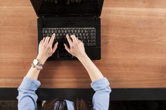 The secretary writes on the keyboard with both hands, a view fro. M above royalty free stock photography