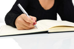 Secretary writing in her notepad Royalty Free Stock Images