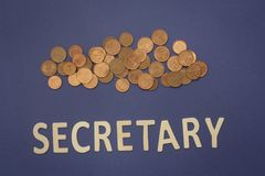 Secretary written with wooden letters on a blue background. To mean a business concept Stock Photography