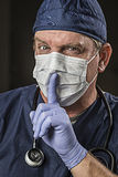 Secretive Doctor Wearing Protective Head Wear Royalty Free Stock Photo