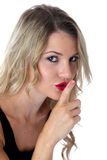 Secretive Frightened Young Woman With Finger to Lips Stock Photography