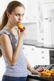 Secretive Girl Eat Cake Stock Image
