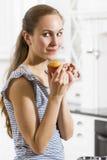 Secretive Girl Eat Muffins Royalty Free Stock Image