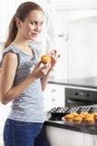 Secretive Girl Eat Muffins Royalty Free Stock Photos