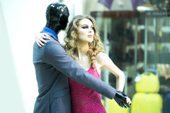 Secretive girl and mannequin Stock Photography